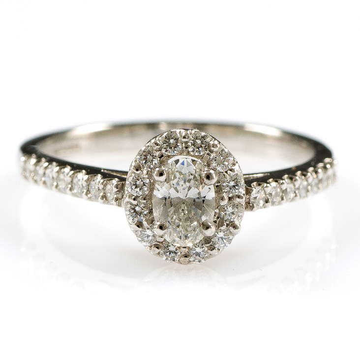 28f1be0e08644 Platinum claw set oval cut Diamond ring